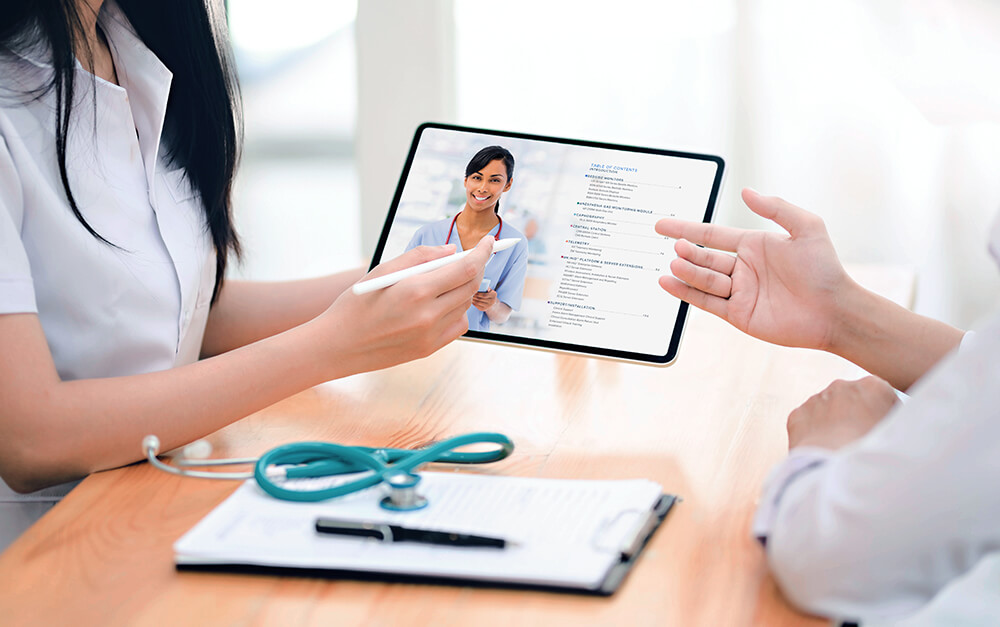 A doctor and patient going over a digital brochure