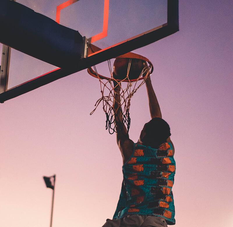 a man dunking a basketball