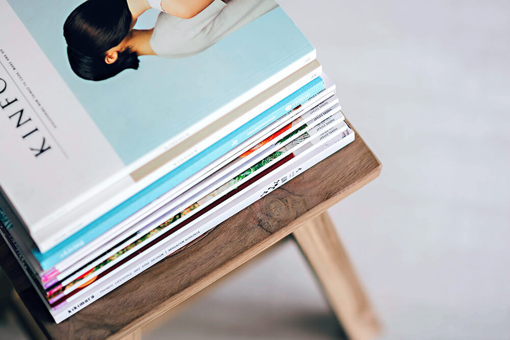 Magazines sit in a pile because everyone is reading the digital version