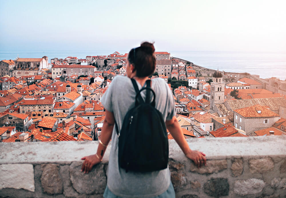 A woman traveling the world wishing she had a digital guide she could use