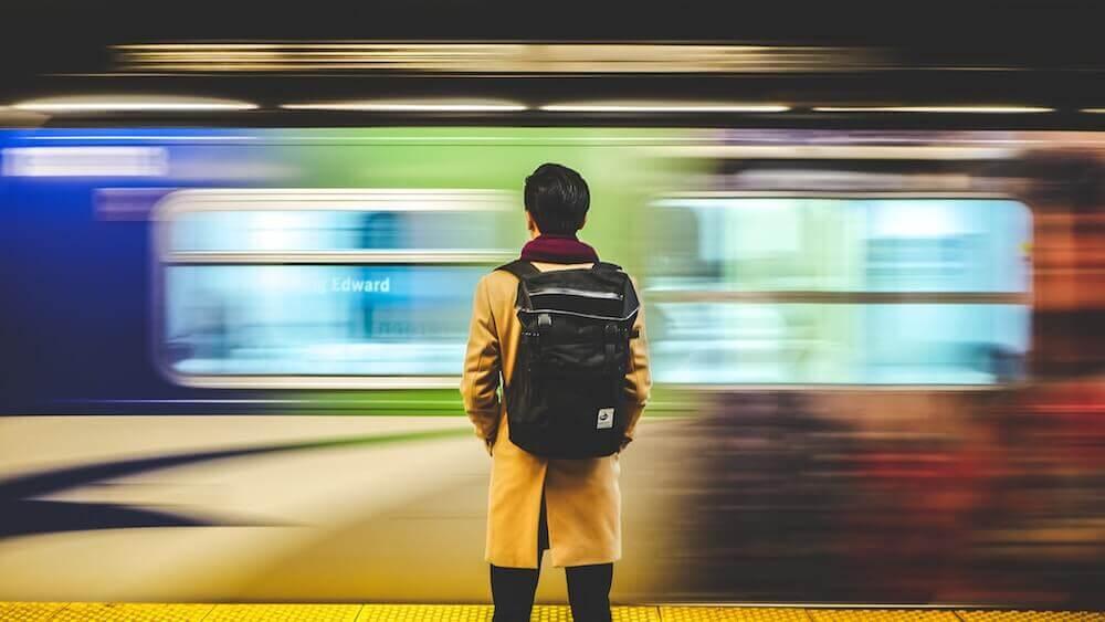 stock photo of a man looking at a subway train